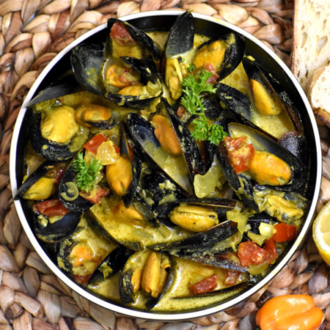 Caribbean Coconut Mussels in a bowl.