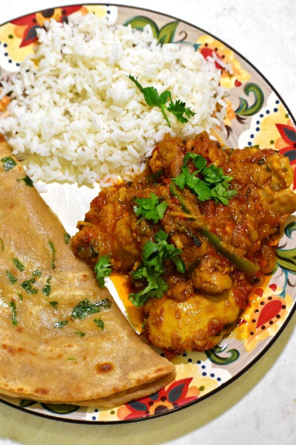chicken masala on the gypsy plate alongside rice and roti