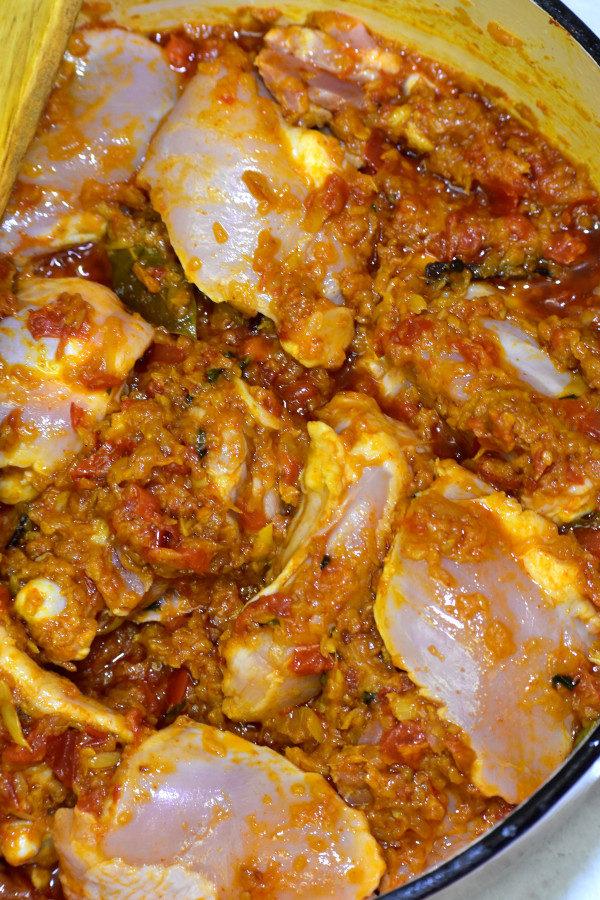 raw chicken thighs added to masala