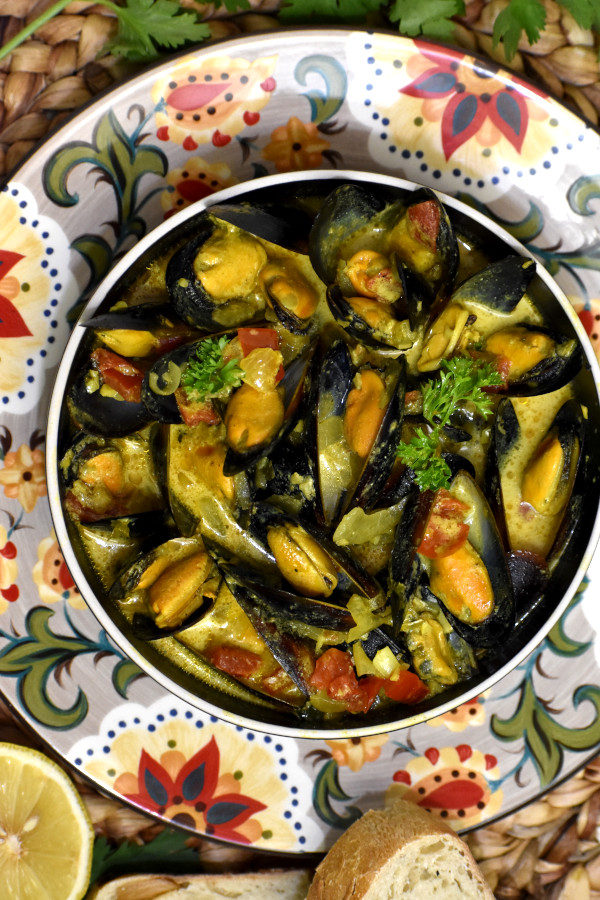 caribbean coconut mussels in a bowl on the gypsy plate