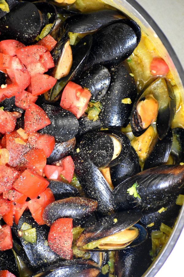 mussels after adding diced tomatoes, in preparation for coconut curry mussels