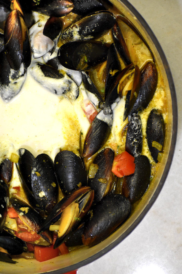 caribbean coconut mussels after adding coconut milk