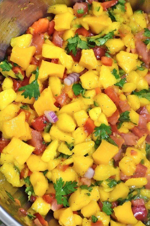 closeup of mango salsa in a metal bowl