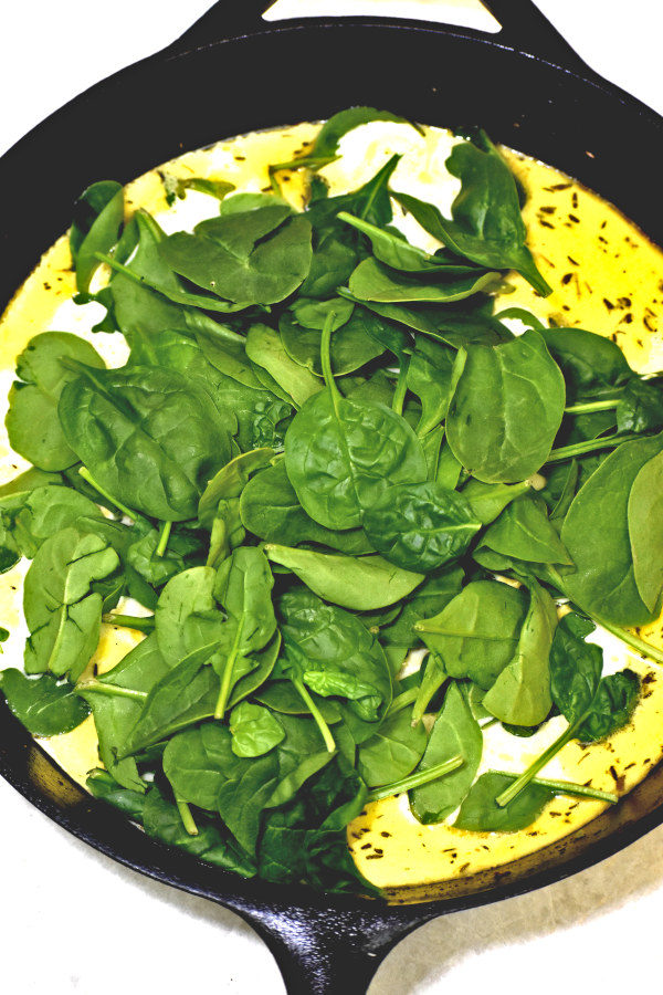 Spinach added to sauce for Creamy Lemon Chicken.