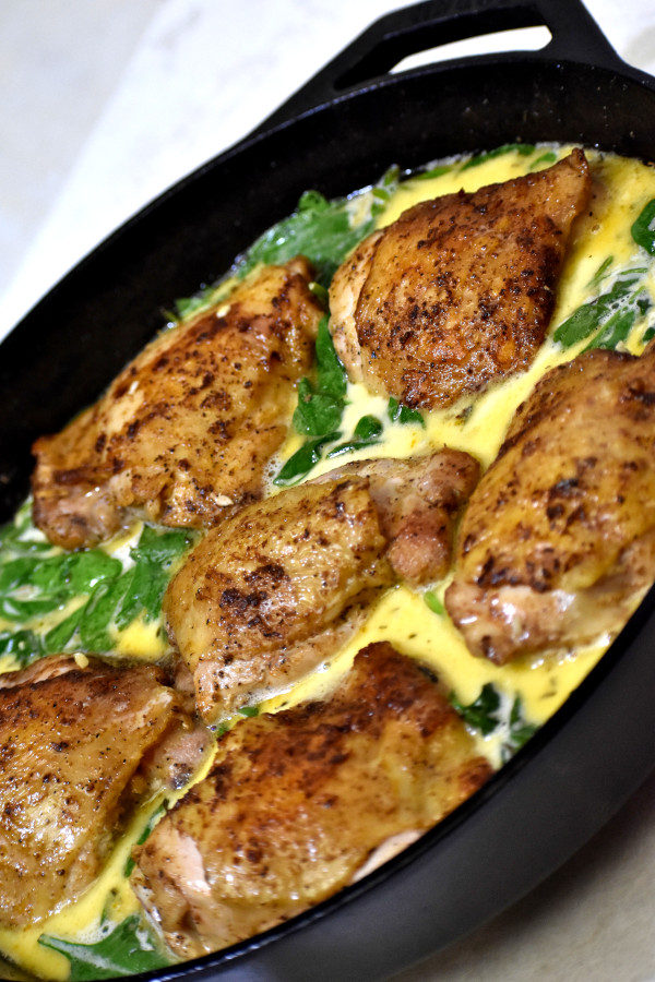Creamy Lemon Chicken assembled in cast iron skillet and ready to go in the oven.