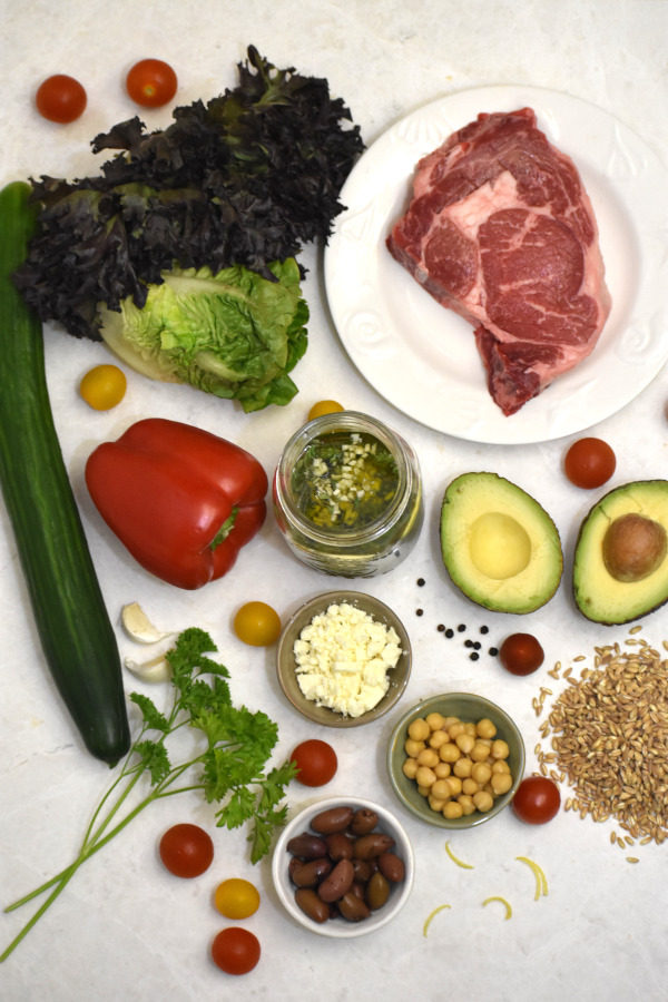 ingredients for greek salad bowl viewed from above