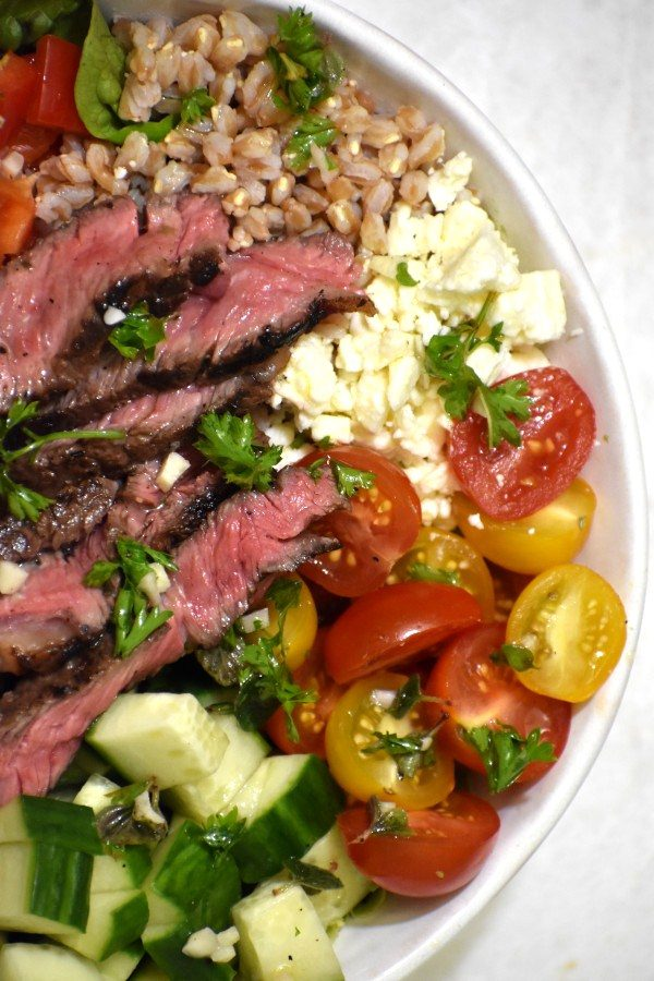 close up of greek steak salad bowl viewed from above
