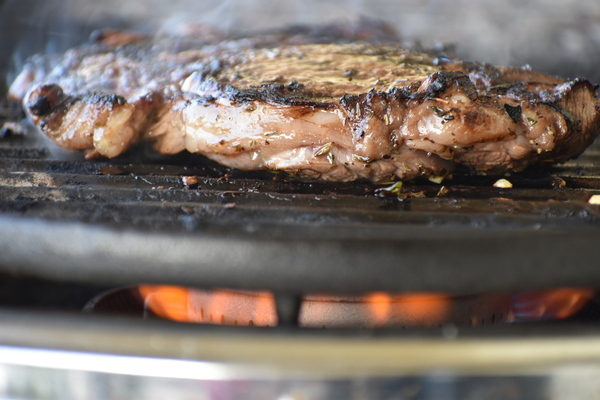cooked ribeye steak on grill