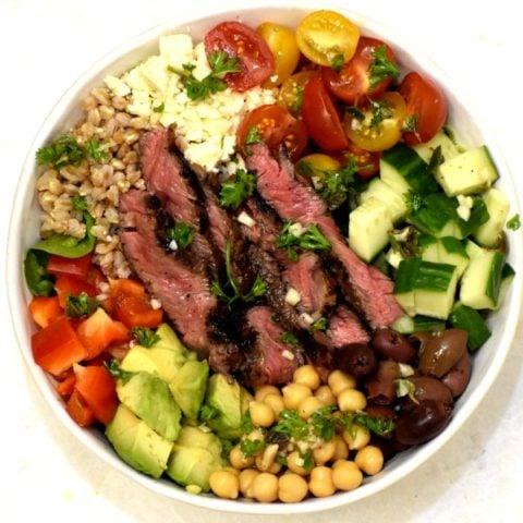 greek steak salad bowl viewed from above