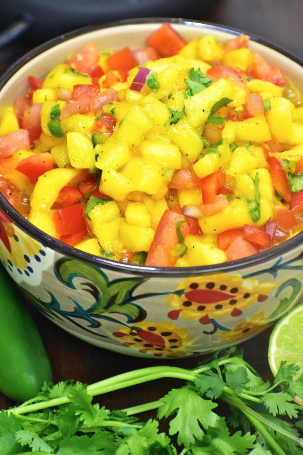 mango salsa in the gypsy bowl with cilantro, lime and a jabanero pepper in the forground