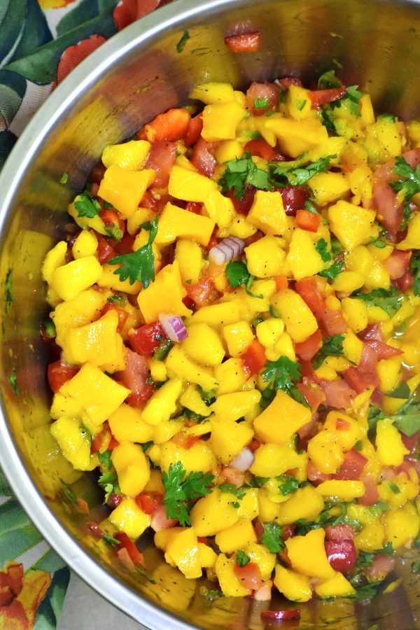 mango salsa in a stainless steel bowl