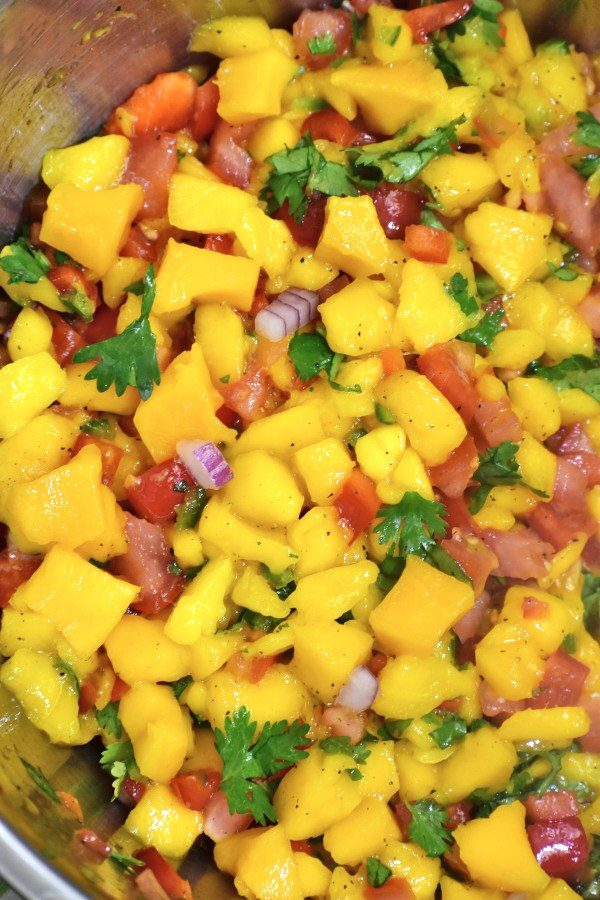close up of mango salsa in a stainless steel bowl
