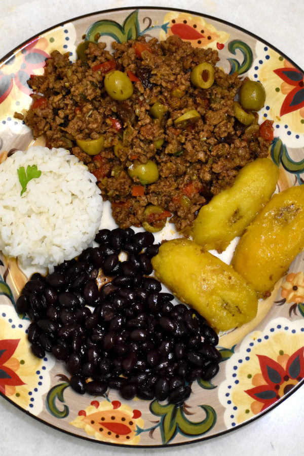 puerto rican picadillo with white rice, black beans and plantains on the gypsy plate