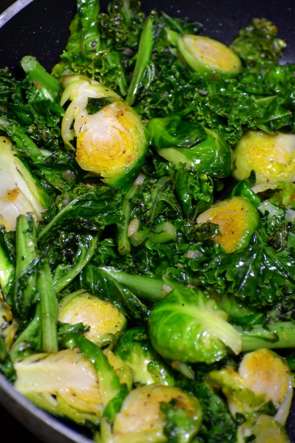 close up of cooked kale and halved brussels sprouts