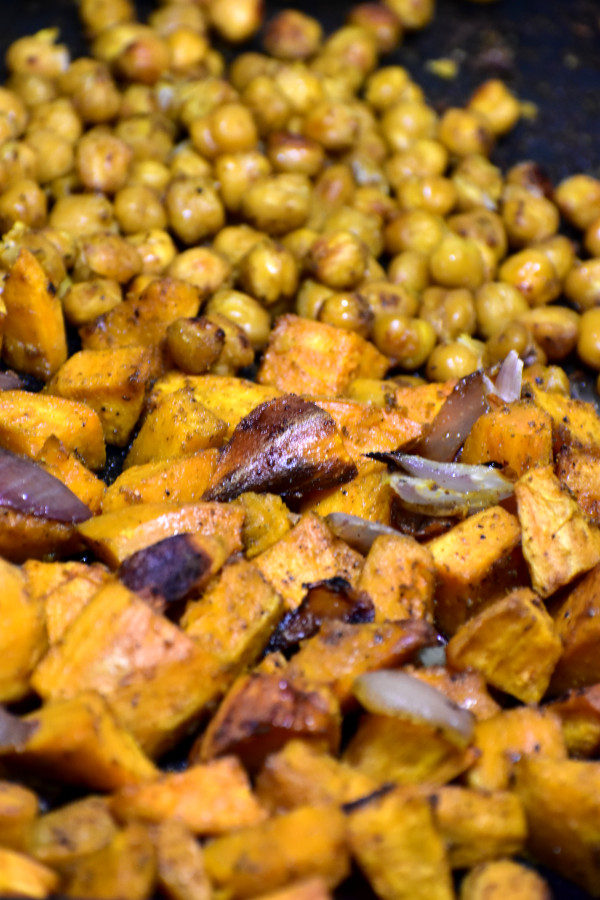 close up of roasted sweet potatoes, onions and chick peas