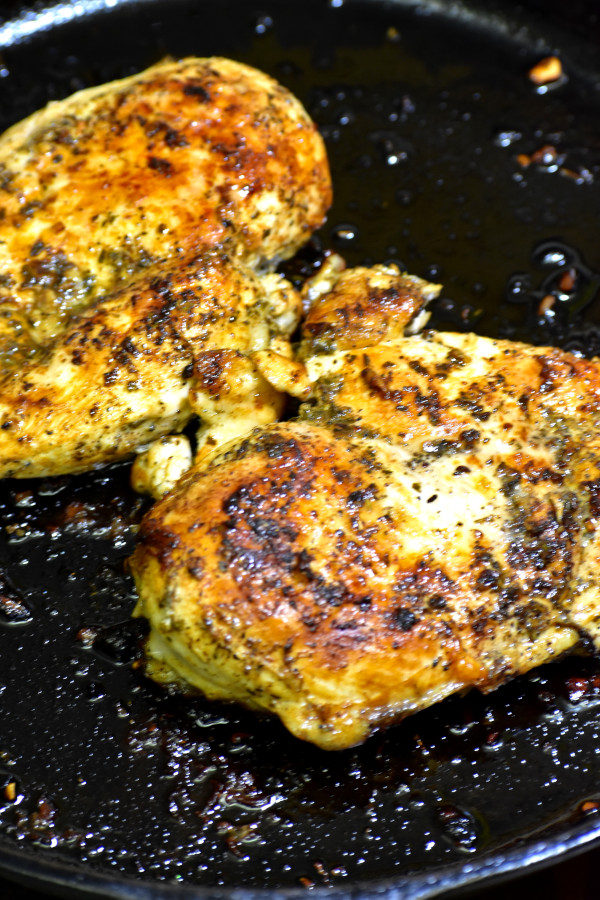 cooked chicken breasts in a cast iron skillet