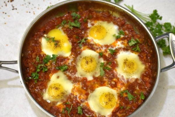 eggs nestled in the tomato base