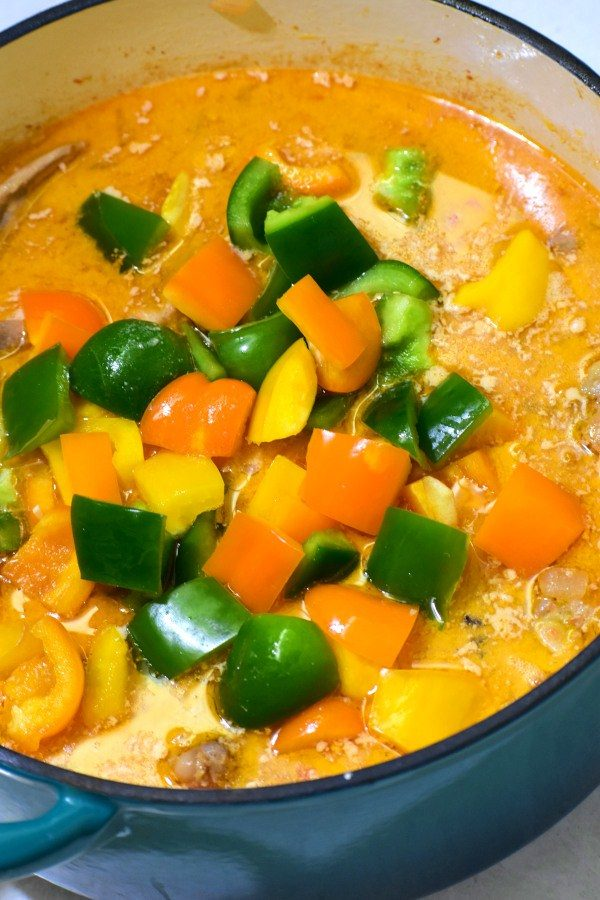 green, yellow and orange bell peppers, recently added to caldereta sauce