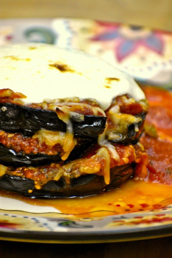 closeup side view of one stack of eggplant parmesan on the gypsy plate