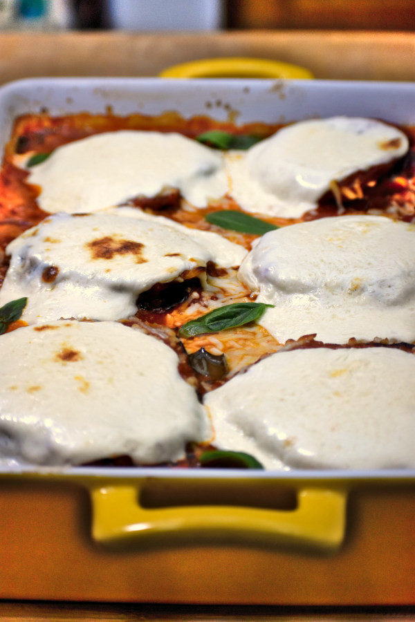 Dish of eggplant parmesan fresh out of the oven.
