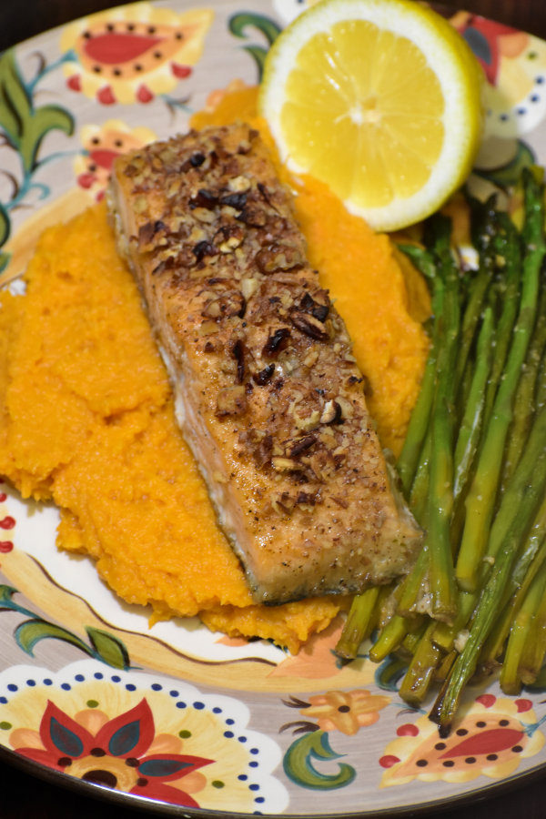 maple pecan salmon with sweet potato mash, roasted asperagus and fresh lemon slices on the gypsy plate