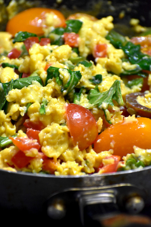 side view of stunning scrambled eggs in pan