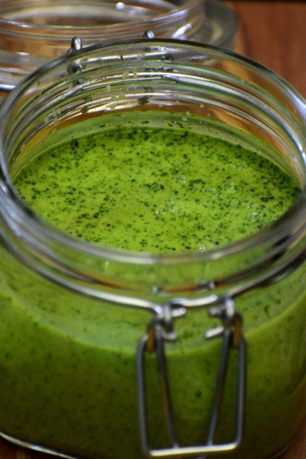 cilantro mint chutney in a glass storage jar