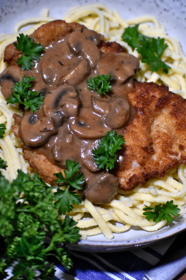 jagerschnitzel in a bowl with spaetzle