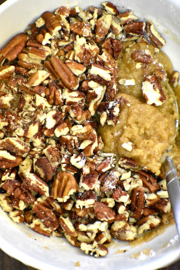 mixture of melted butter, flour and brown sugar with crushed pecans added in