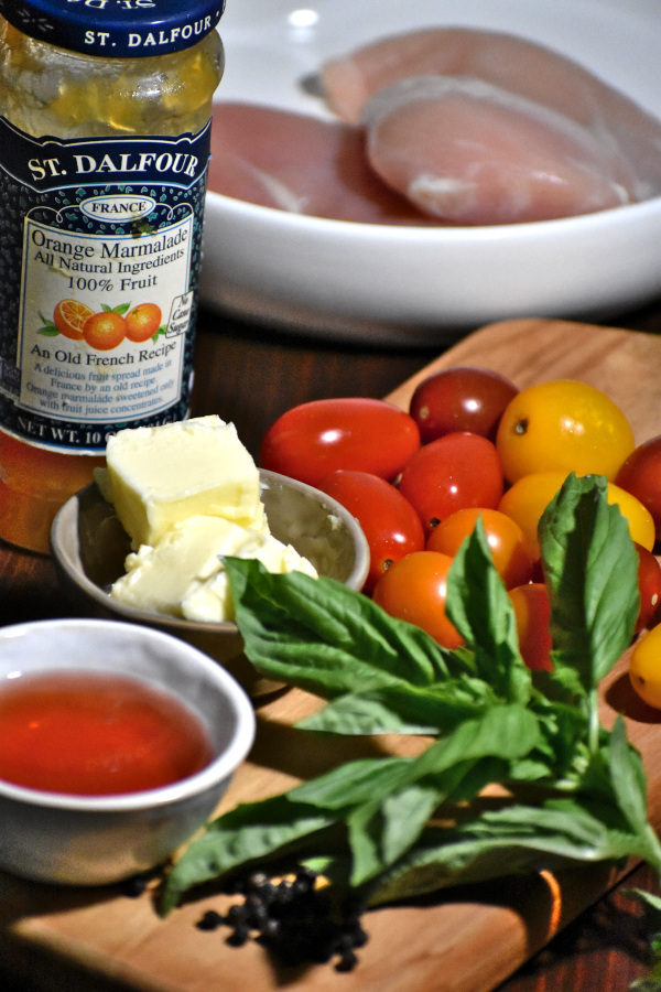 side view of ingredients for tomato basil chicken