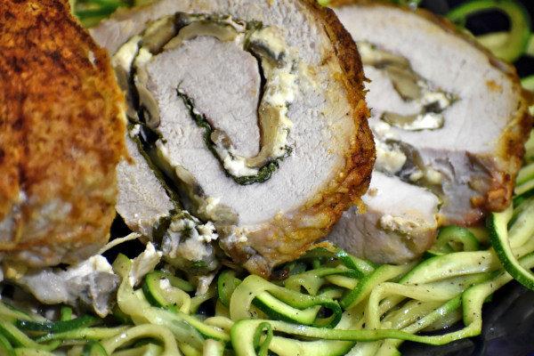 close up of three pork pinwheels atop zucchinicci