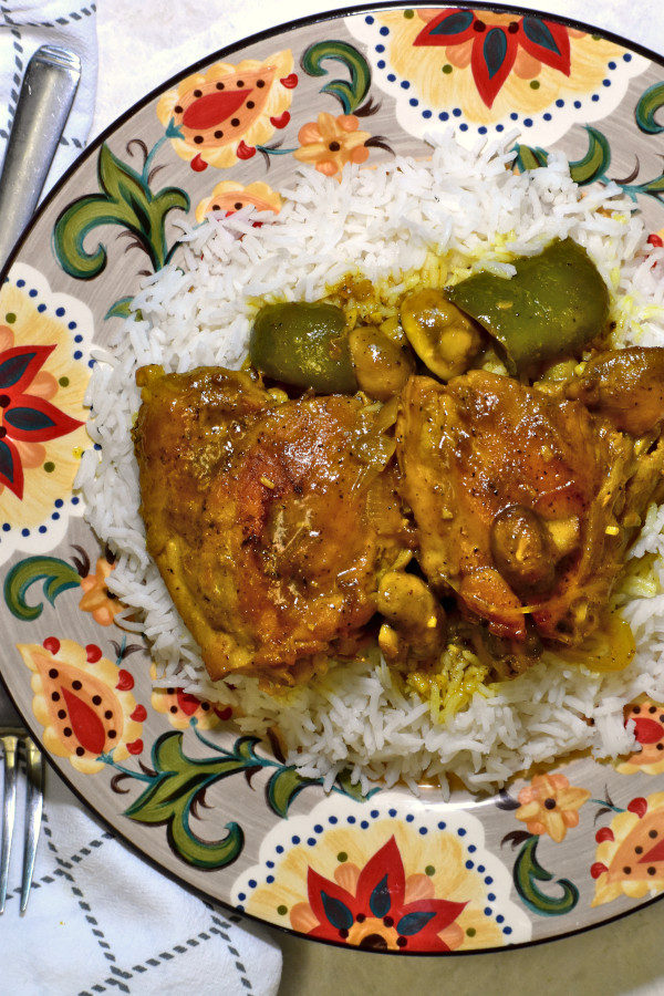 south african chicken curry atop a bed of rice on the gypsy plate