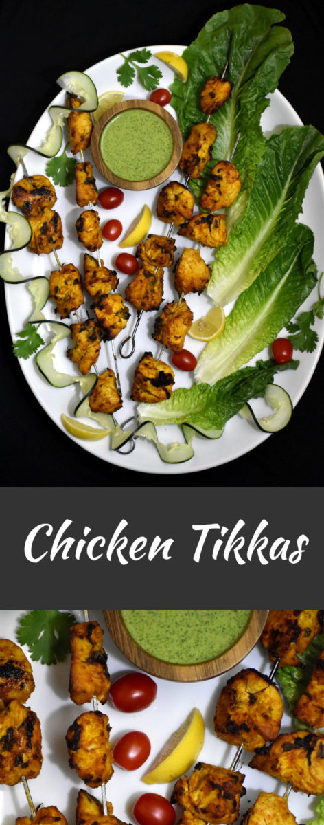 vertically split image. the top picture has four chicken tikka kebabs on a white platter along with lettuce leaves, cherry tomatoes, lemon slices and a small wooden bowl of mint chutney. below this picture is a zoomed in picture of one of the tikkas.