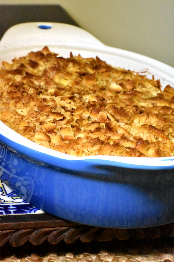 southern squash casserole in a blue baking dish