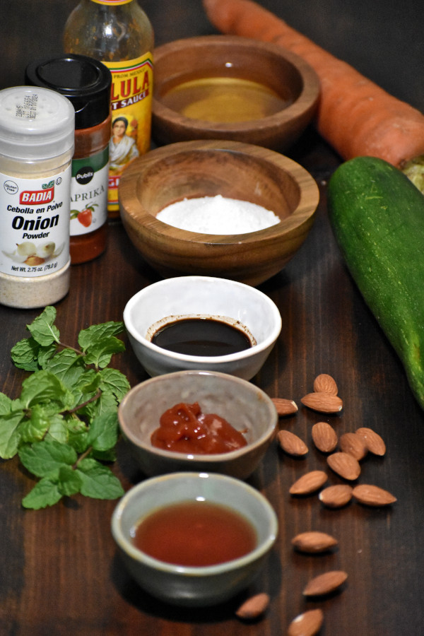 ingredients for zucchini carrot salad with catalina dressing on a wooden surface