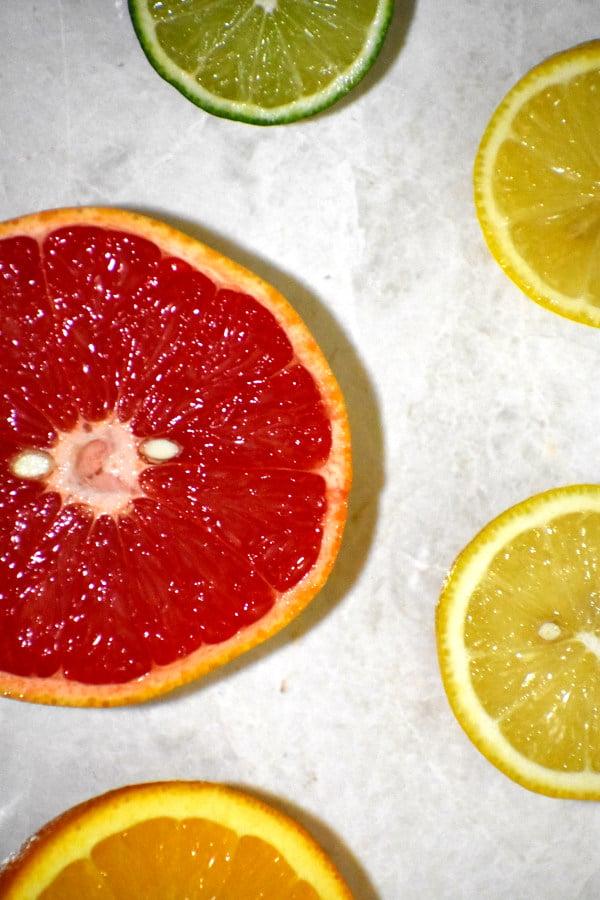 sliced citrus on a white background