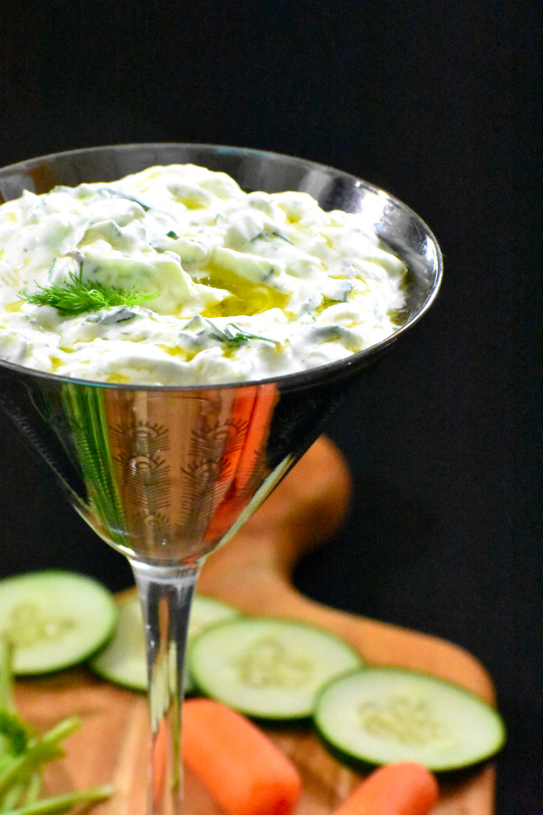 colse up side view of tzatziki in a silver colored martini glass