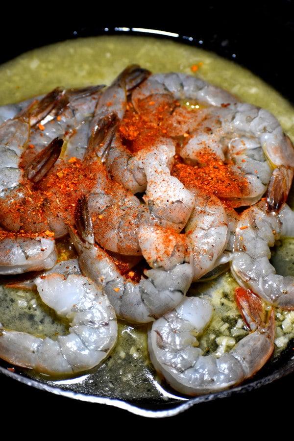 raw shrimp wit cajun seasoning sprinkled on top