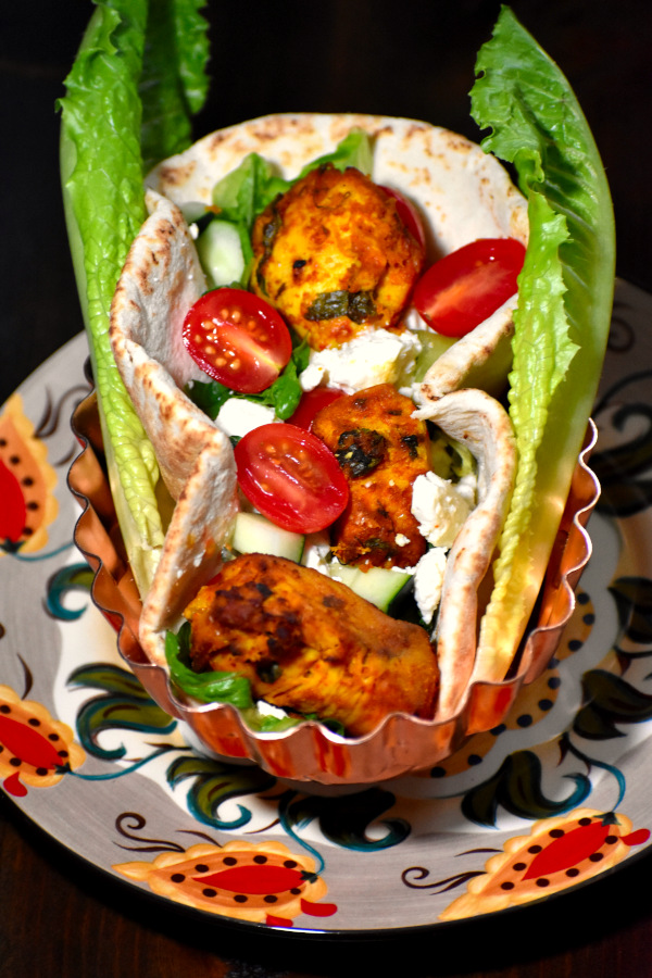 chicken tikka gyro in a metal bowl on the gypsy plate