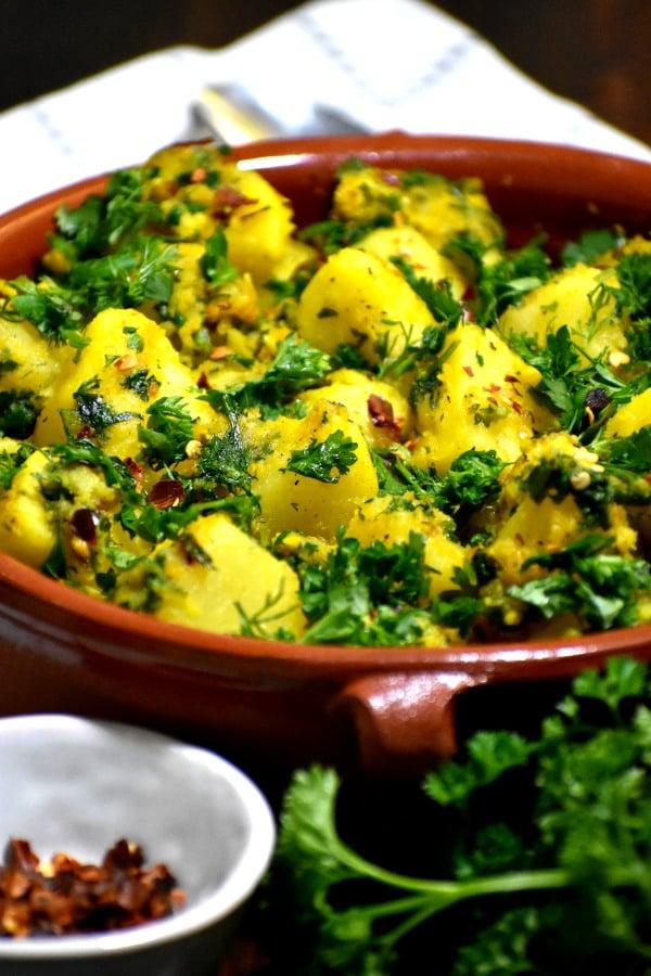 batata harra in a red bowl