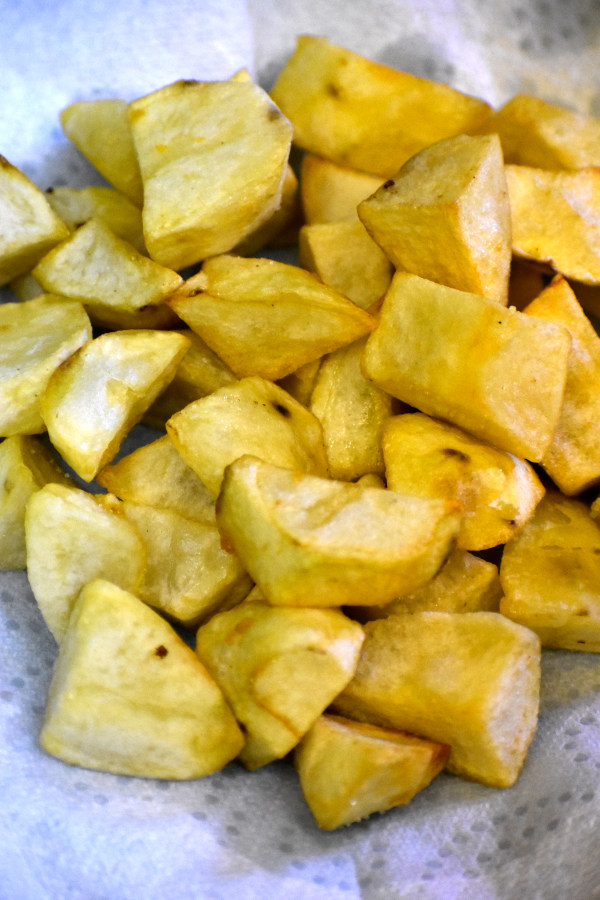 fried potato chunks on a paper towel