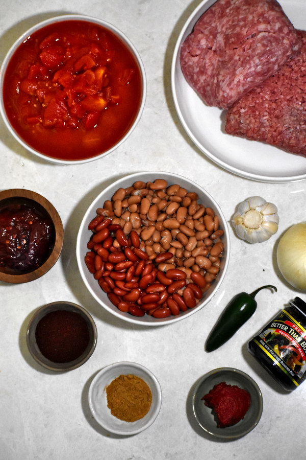 ingredients for smoky chipotle chili on a white background