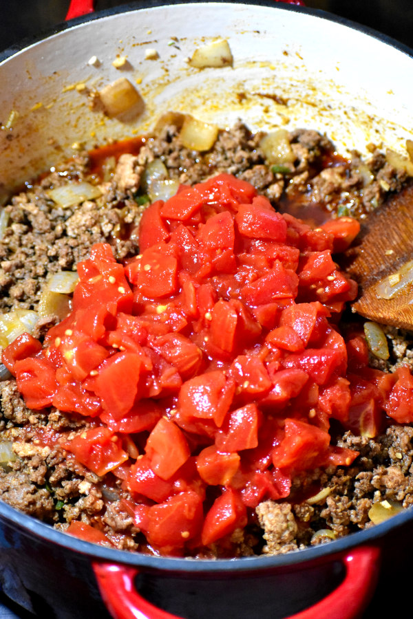 browned, spiced meat mixture topped with diced tomatoes