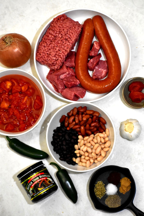 ingredients for ultimate chili displayed on a white background