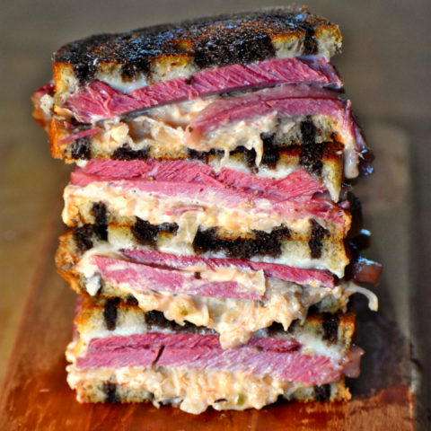 reuben sandwiches stacked up