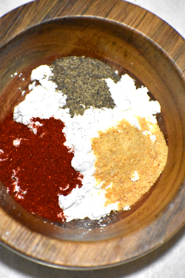 spices in a small wooden dish
