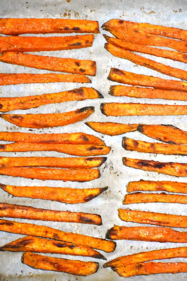 cooked sweet poatato fries on baking sheet