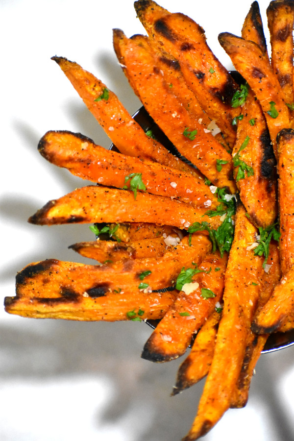 overhead shot of sweet potato fries in a round dish