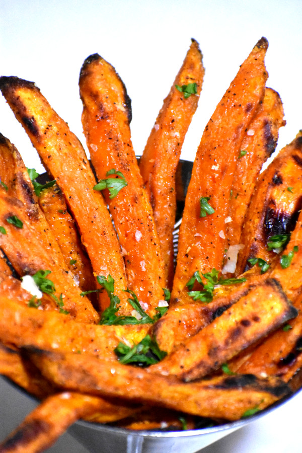 side shot of sweet potato fries in a round dish