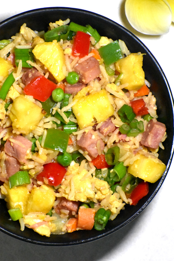 Close up of one of these bowls of tropical fried rice.